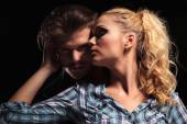 Blonde woman looking away and embracing her boyfriend — Stockfoto