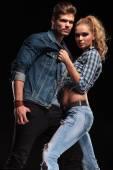 Blonde sexy woman pulling her boyfriend collar — Stock Photo