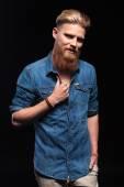Man with long red beard fixing his collar — Stock Photo