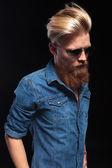 Fashion man in blue shirt looking down — Stock Photo