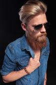 Fashion man in blue shirt pulling his collar — Stock Photo