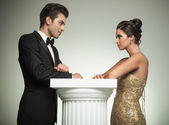 Elegant man and woman  look at each other — Stock Photo