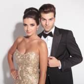 Elegant couple posing together on studio background — Stock Photo
