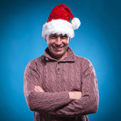 Mid aged man wearing a santa hat — Stock Photo