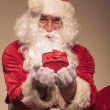 Santa Claus giving you a present — Stock Photo #57128913