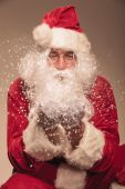 Santa Claus blowing snow to the camera. — Foto Stock