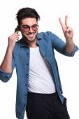 Ashion man showing the victory sign  — Stock Photo