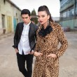 Fashion couple posing near old factory. — Stock Photo #58758819
