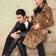 Young fashion couple sitting on old factory ruins — Zdjęcie stockowe #58758901