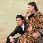 Beautiful fashion woman sitting on her boyfriend's lap — Stock Photo #58758927