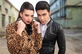 Young fashion couple posing near old factories. — Stock Photo