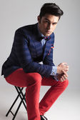 Fashion man resting on a stool  — Stock Photo