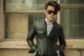 Fashion man posing near old building — Stock Photo