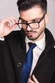 Handsome business man putting on his glasses — Stock Photo