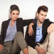 Beautiful fashion woman sitting next to her boyfriend — Stock Photo #63262443