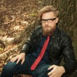 Blond beard fashion man sitting near a tree — Stock Photo #63262849