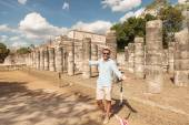 Happy man inviting you to visit the ruins — Stock Photo