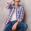 Pensive young casual man sitting — Stock Photo #78385594