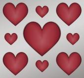 Coeurs en relief sur fond gris — Vecteur