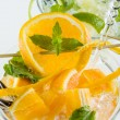 Orange and lime Mojito over white background — Stock Photo #51864003