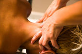 Woman receiving professional massage. — Stock Photo