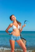 Woman with jeans shorts and bag — Stock Photo