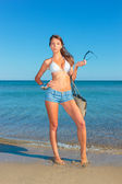 Woman with jeans shorts and bag — Foto de Stock