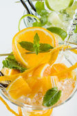 Orange and lime Mojito over white background — Stock Photo