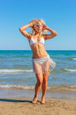 Lady dancing on the beach — Stock Photo