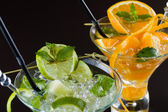 Orange and lime Mojito over black  background — Stock Photo