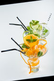 Orange and lime Mojito over black and white background — Stock Photo