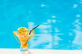 Orange Mojito by the swimming pool — Stock Photo