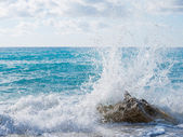 Waves breaking on a stony beach  — Stock Photo