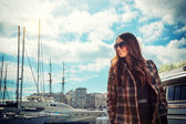 Young woman at the harbor  — Stock Photo
