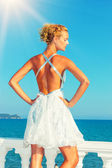 Fashion model by the sea in Greece — Stock Photo