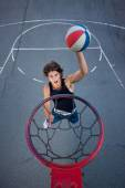 Young basketball player on the street going to the hoop.  — Stock Photo