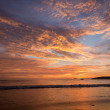 Tropical sunset on the beach. Ao-Nang. Krabi — Stock Photo #57571397