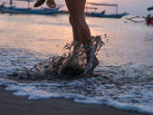 Woman foot on the beach — Stock Photo