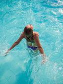 Top view of a woman in bikini at the pool — Stock Photo