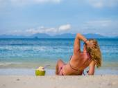 Woman on the beach with coconut drink  — Stock Photo