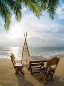 Table on the beach at dusk — Stock Photo