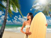 Portrait of an asian woman holding a surf board — Stock Photo
