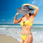 Beautiful woman on the beach. — Stock Photo #65495857