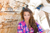 Portrait of sexy brunette woman posing at shipwreck — Stock Photo