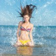 Beauty Model Girl Splashing Water in the ocean — Stock Photo #70758861