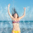 Beauty Model Girl Splashing Water in the ocean — Stock Photo #70759235