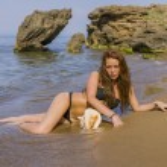Beautiful woman on the beach in Bali — Stock Photo #70874805