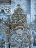 Stone sculpture on entrance door of a temple — Stock Photo