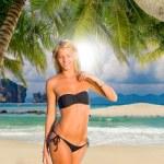 Woman on a tropical beach — Stock Photo #76040067