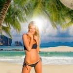 Woman on a tropical beach — Stock Photo #76040357